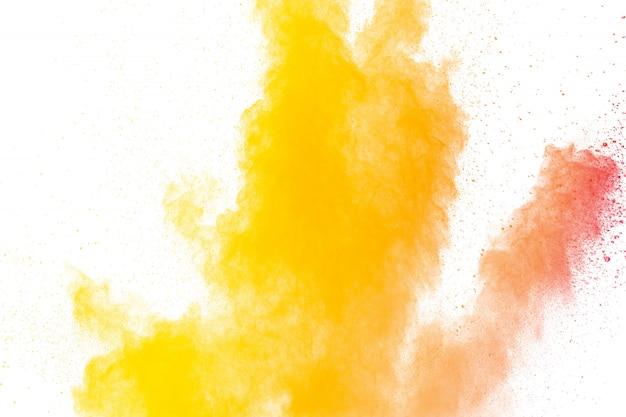 Abstract yellow orange powder explosion.
