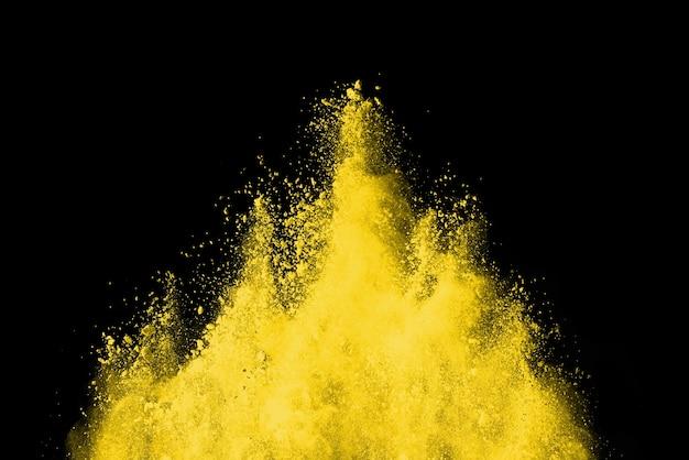 抽象的な黄色い粉の爆発