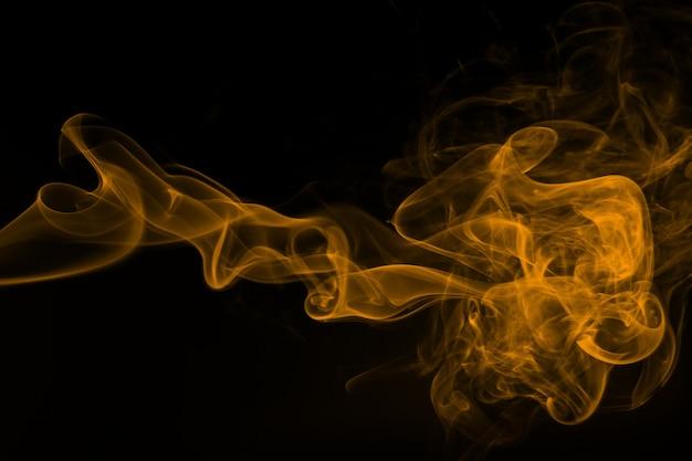 流れる抽象的な黄色い煙