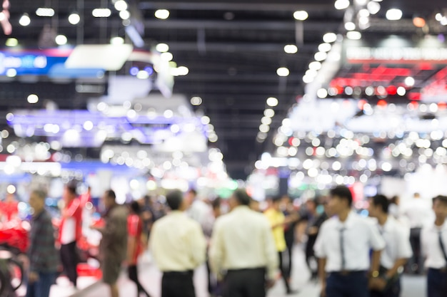 Abtract blur people in exhibition hall motor show event background