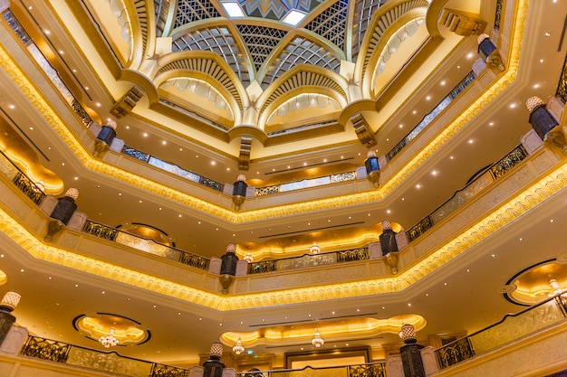 Abu dhabi, uae - march 16: dome decoration in emirates palace hotel on march 16, 2012. this is a luxurious and the most expensive 7 star hotel designed by renowned architect, john elliott riba.