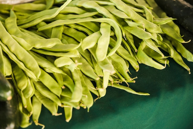 Abundance of flat beans on table at supermarket
