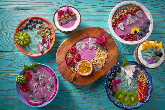 Acai bowl smoothie and spirulina algae with berries