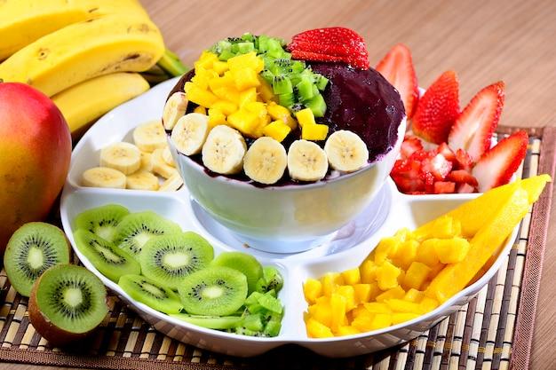 Açaí bowl with fruits salad banana, mango, kiwi and strawberry
