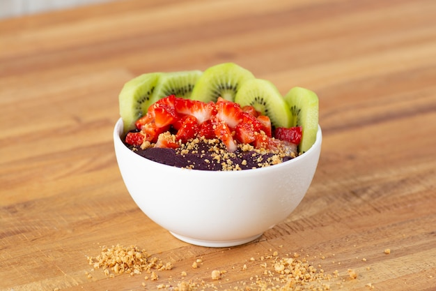 Açaí bowl with strawberry and mango topping