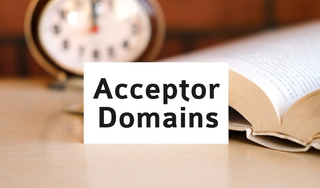 Acceptor domain business concept text on a white book and clock