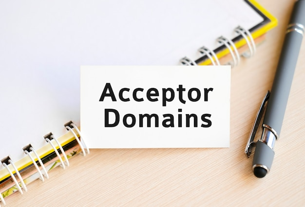 Acceptor domain - text on a notebook with a spring and a gray pen
