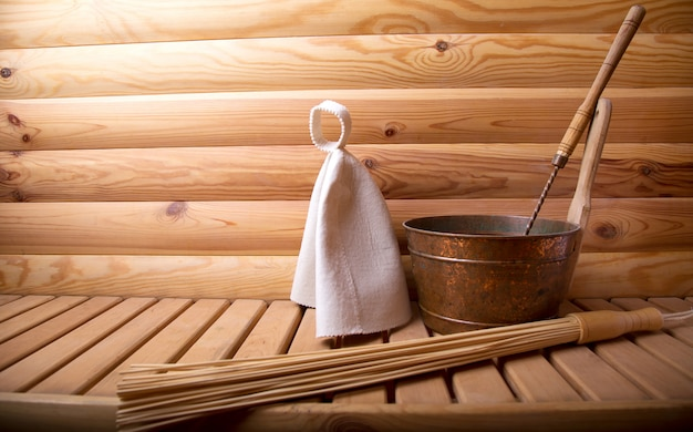 Accessories for  bath and sauna on a wooden sauna.