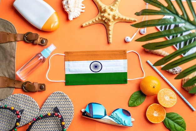 Accessories for beach holidays around a protective mask with the flag of india