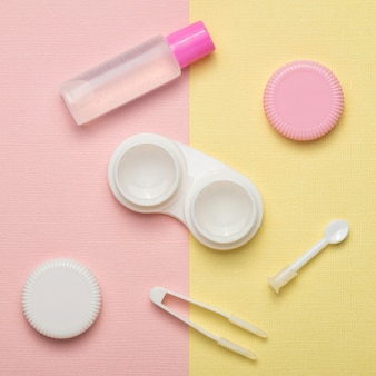 Accessories for contact lenses on a multicolored background. the view from the top.