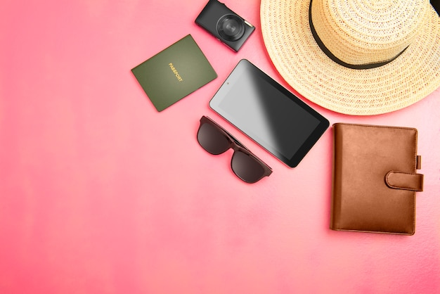 Accessories and equipment such as hat, wallet, camera, tablet, sunglasses and passport for traveling