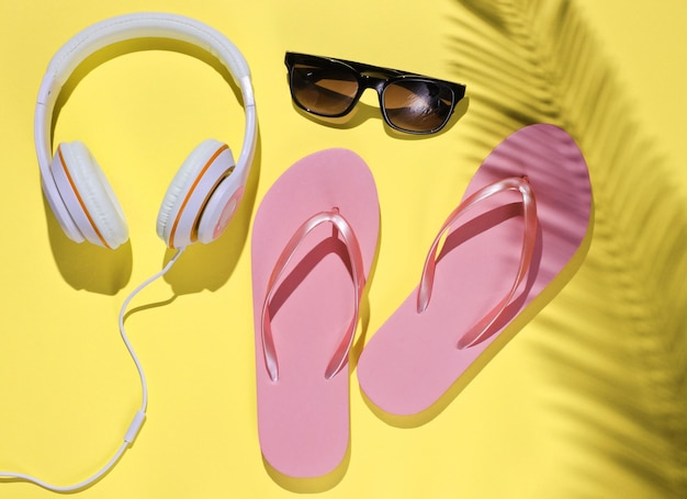 Accessories for relaxing on the beach flip flops headphones sunglasses