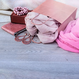 Accessories set for women, wooden light background.