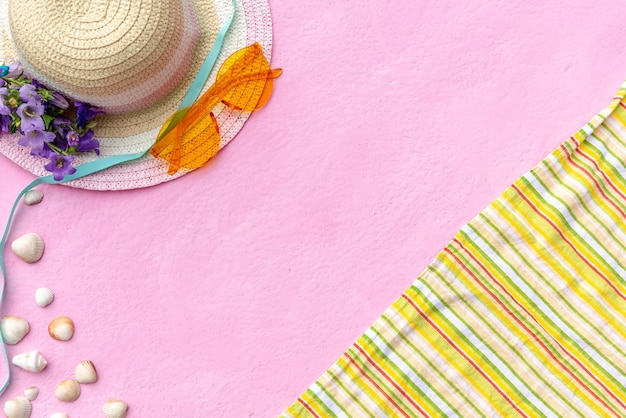 Accessories for summer holidays. hat, glasses, and blanket.