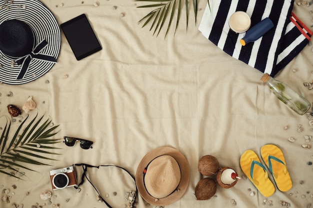 Accessories for summer holidays, top view background