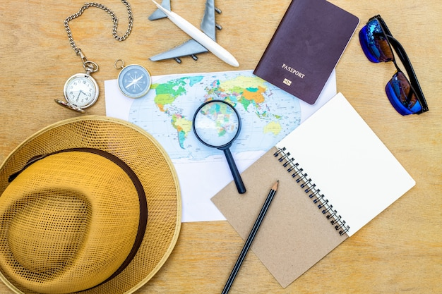 Accessories for travel top view on wooden background