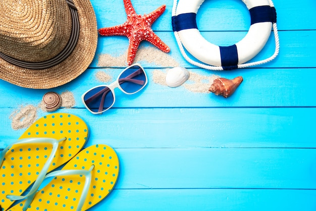 Accessories with woman for travel summer. on blue wooden floor background