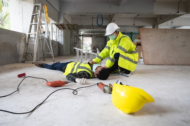 An accident of a man worker at the construction site. the assist those injured in the primary. selection focus on an injured person.
