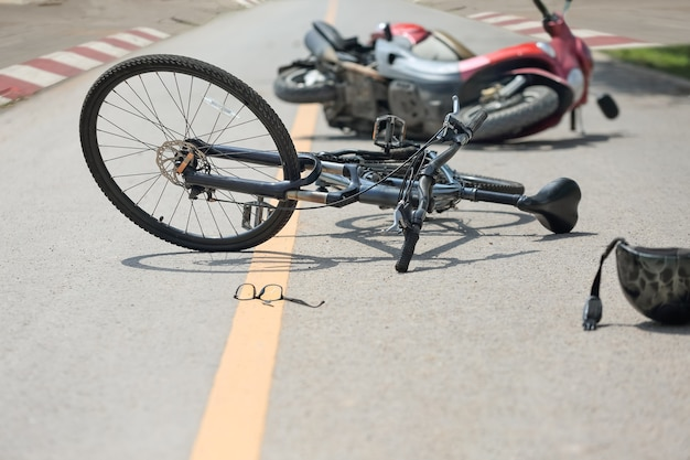 Accident motorcycle crash with bicycle on road