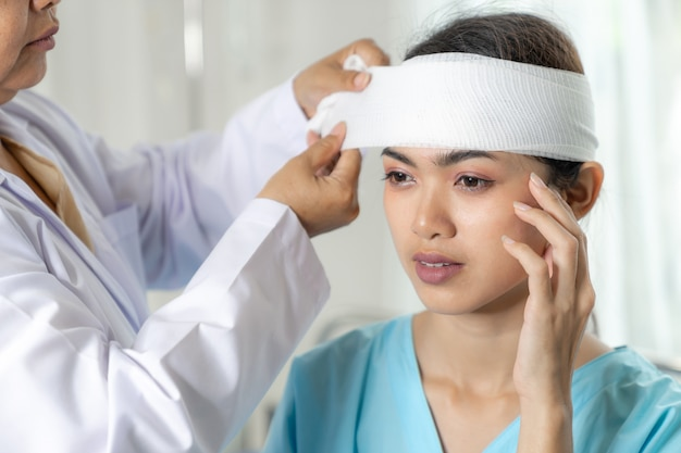 Accident patients injury headache woman in hospital - medical concept