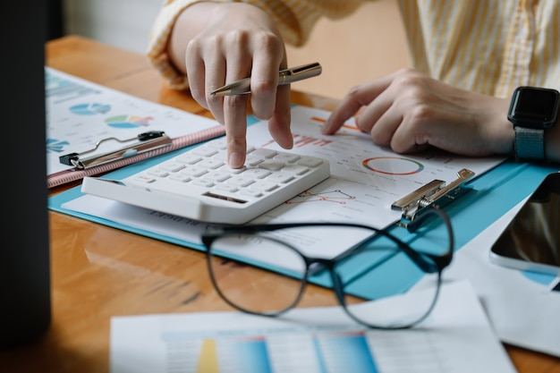 Accountant or banker calculate the financial report with calculator