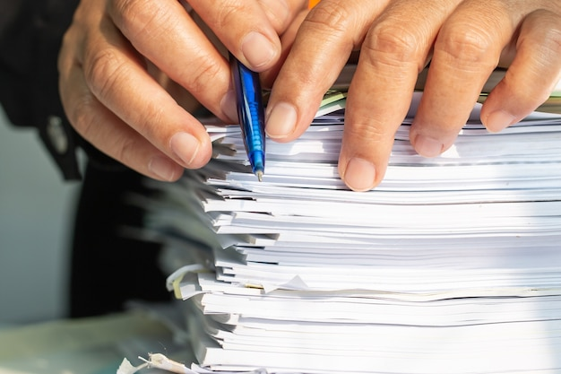 Accountant business man manager checking and signing applicant filling documents reports papers company application form on desk office. document report and business busy concept