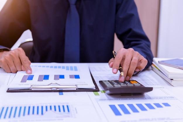 Accountant calculating finances.