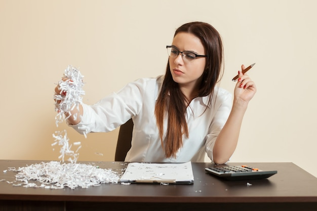 Accountant looks at remains of financial document