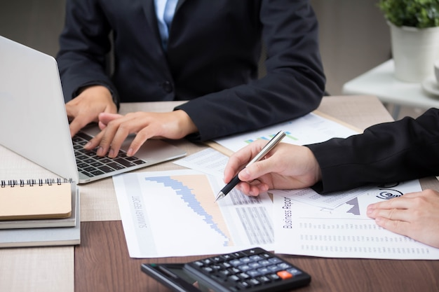 Accountant use calculator  numbers from balance sheet and financial