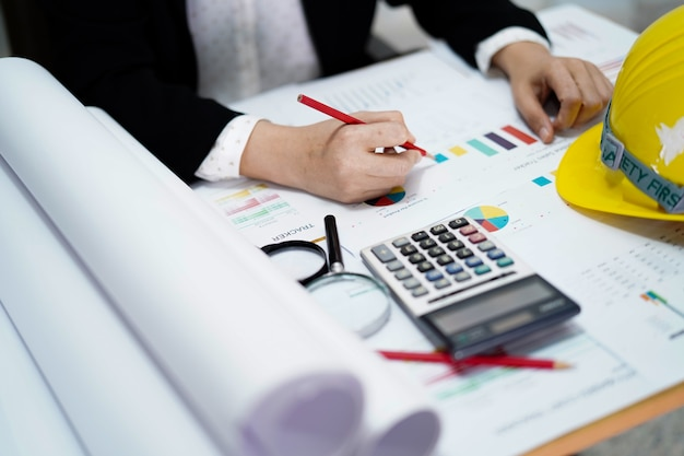 Accountant with calculator on chart paper.