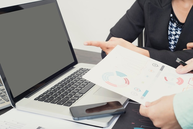 Accountant with document graph financial on office table.