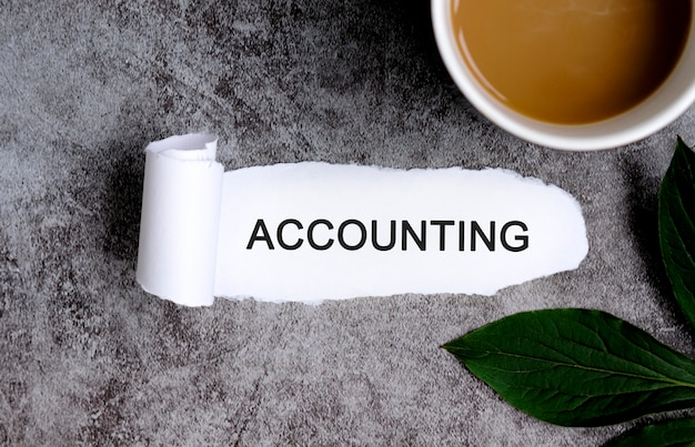 Accounting with cup of coffee and green leaf.