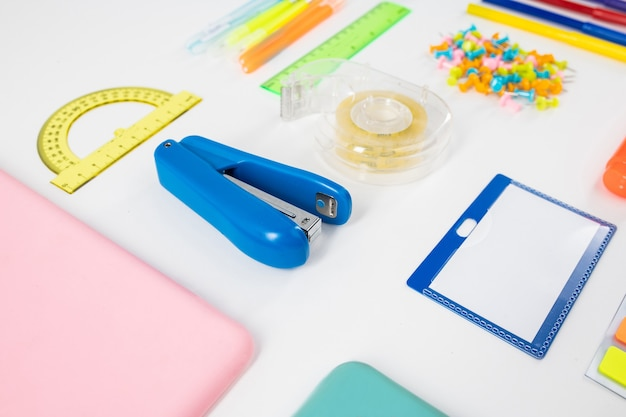 Accurate order. useful stationary tools for easier life collected together lying on the floor