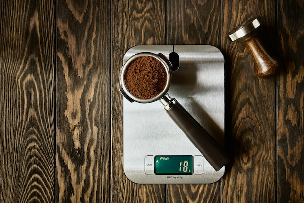 Accurate scale and portafilter with ground coffee