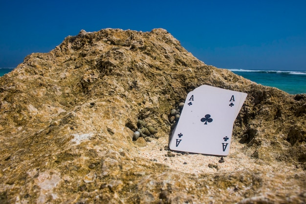 Ace of club poker card beach theme