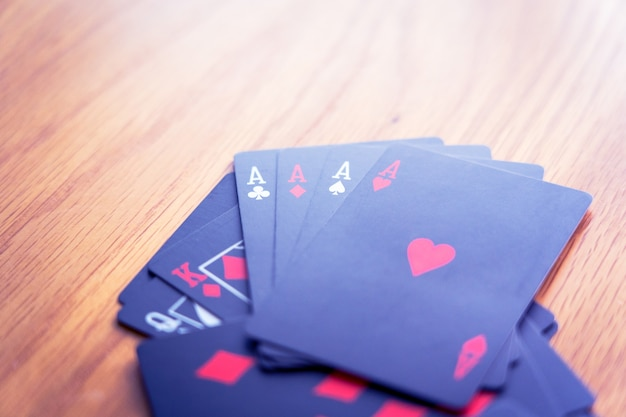 Ace of hearts black cards on the table
