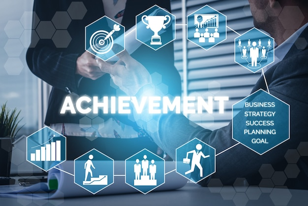 Achievement and business goal success concept - creative business people with icon graphic interface showing employee reward giving for business success achievement