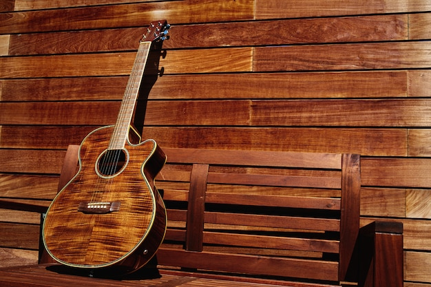 Acoustic brown guitar in wooden stripes