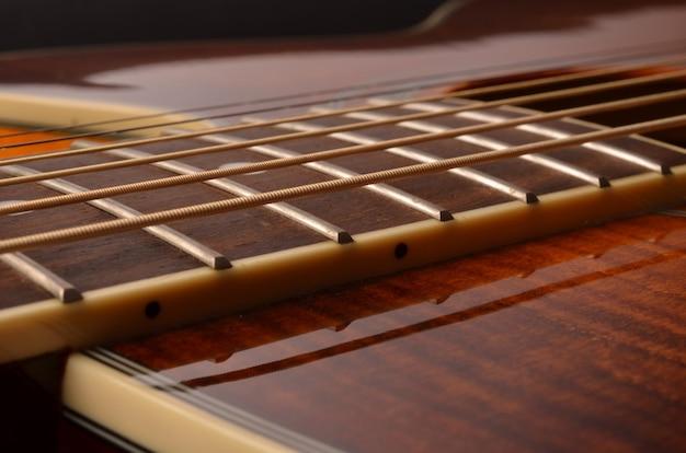 Acoustic guitar elements close up as