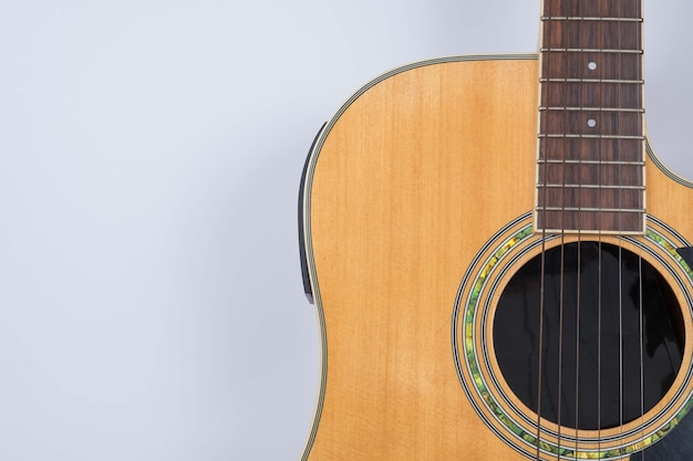 Acoustic guitar on gray background