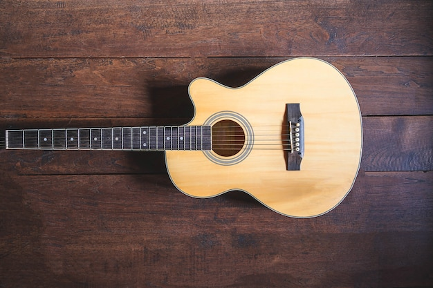 Acoustic guitar instrument on wooden background