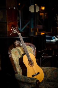Acoustic guitar. music concept. guitar in rusty dark room with lights.room with a guitar.