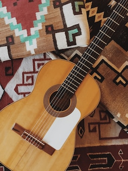 Acoustic guitar on a patterned blanket