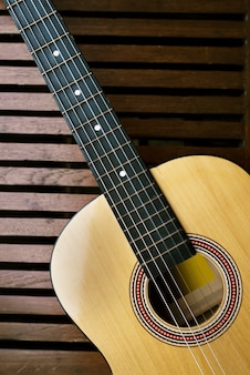 Acoustic guitar on a wooden floor
