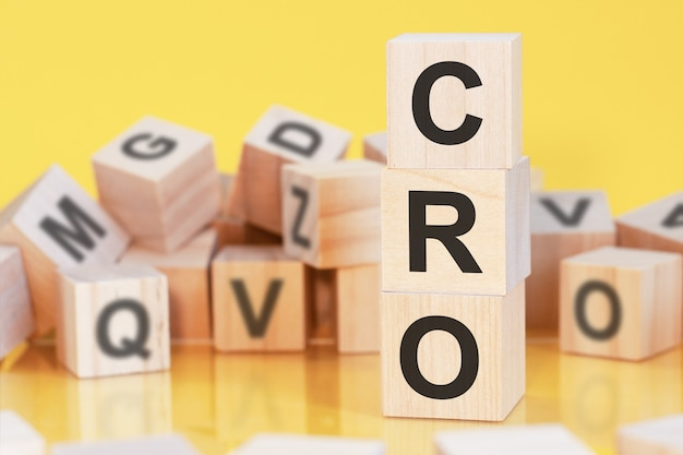 Acronym cro from wooden blocks with letters, concept