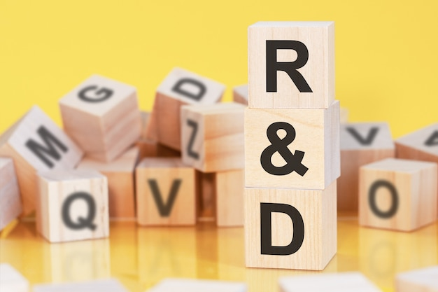 Acronym r and d from wooden blocks with letters, concept