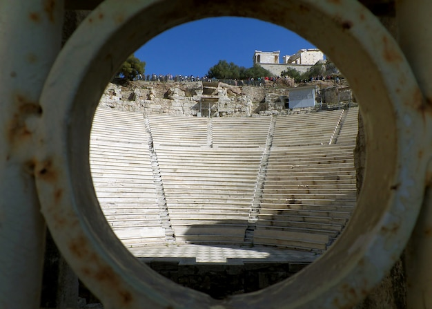 The acropolis as seen from the entrance of odeon of herodes atticus, athens, greece