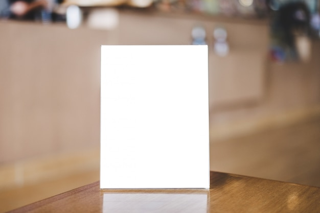 Acrylic blank frame template, blank menu frame on table in coffee shop or restaurant