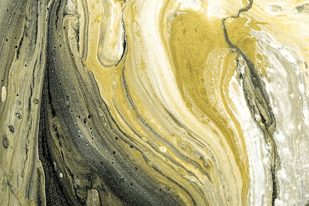 Acrylic fluid art. abstract stone background or texture. liquid black, white and gold marble textures