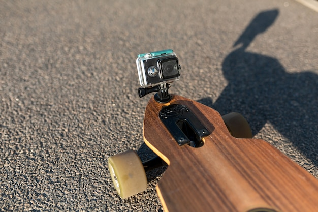 Action camera mounted on longboard nose for filming ride